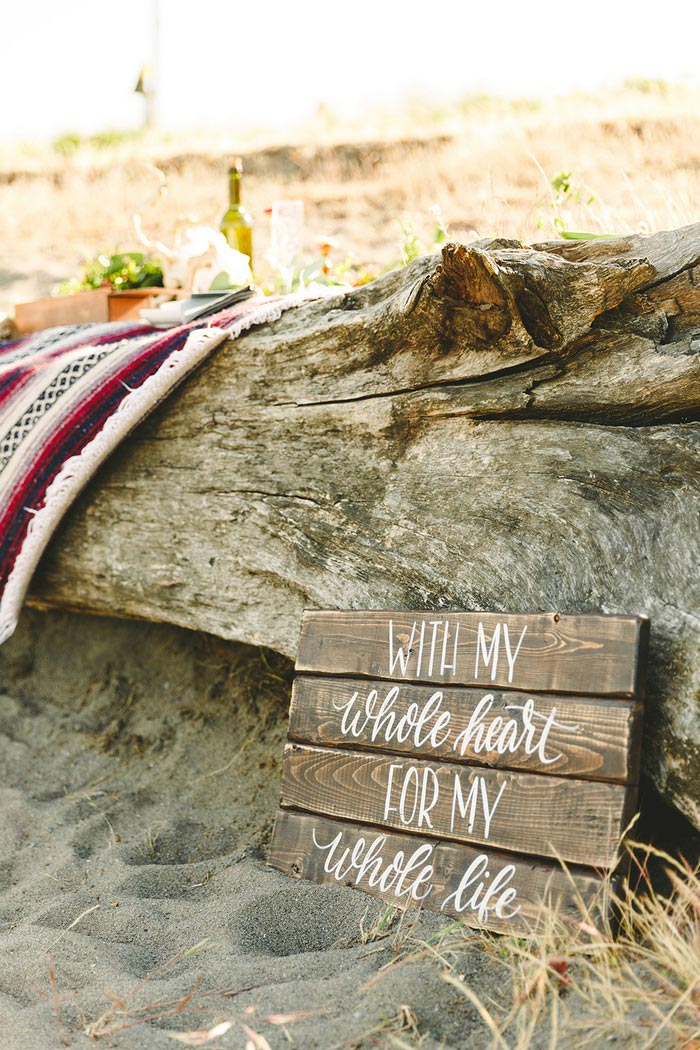 wooden wedding sign on the beach