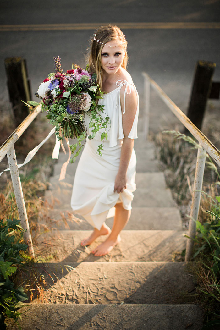 bride on beach steps