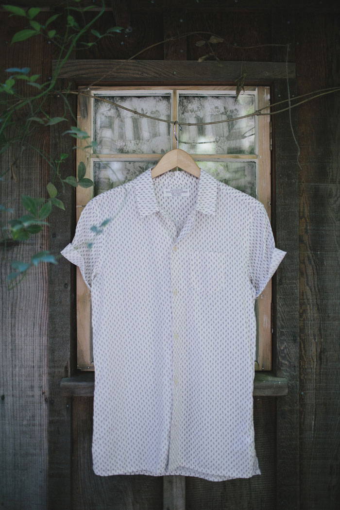 bride's button up shirt hanging up