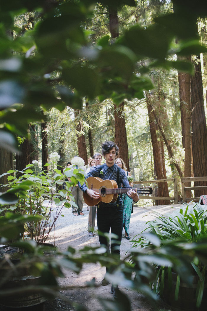 guitarist led wedding procession in the woods