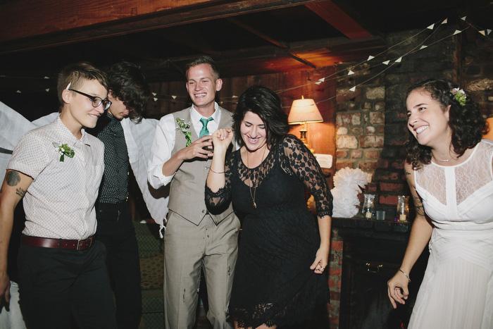 brides dancing with wedding guests
