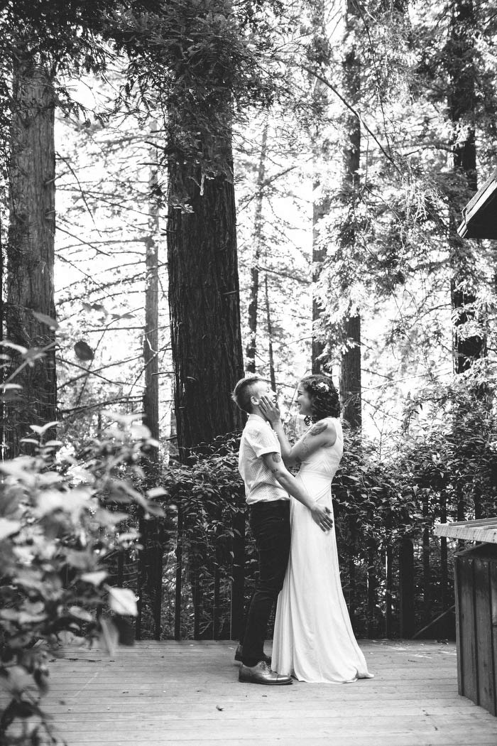 black and white wedding portrait in the woods