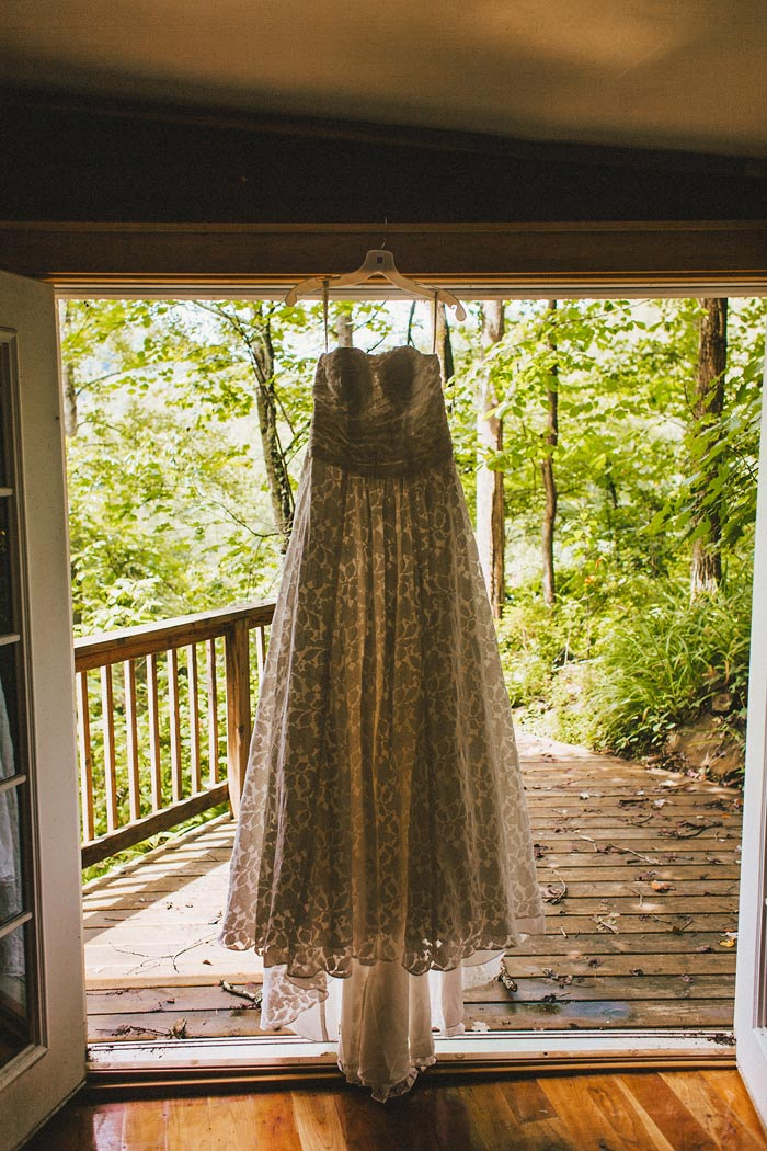 wedding dress hanging up on doorway