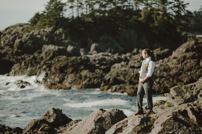 groom waiting by the ocean for his bride