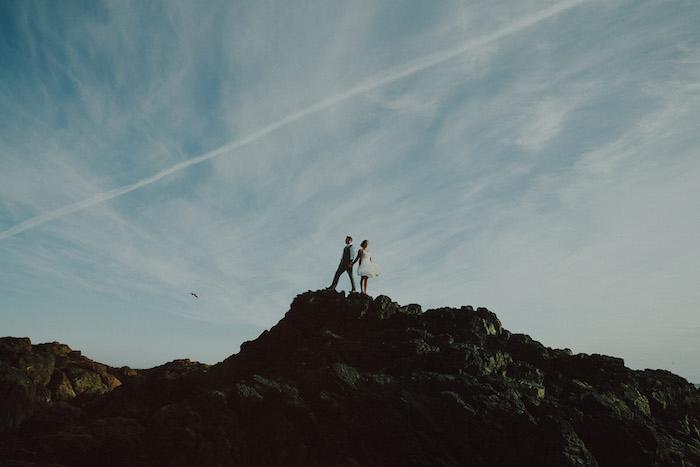 bride and groom portrait atop rocks
