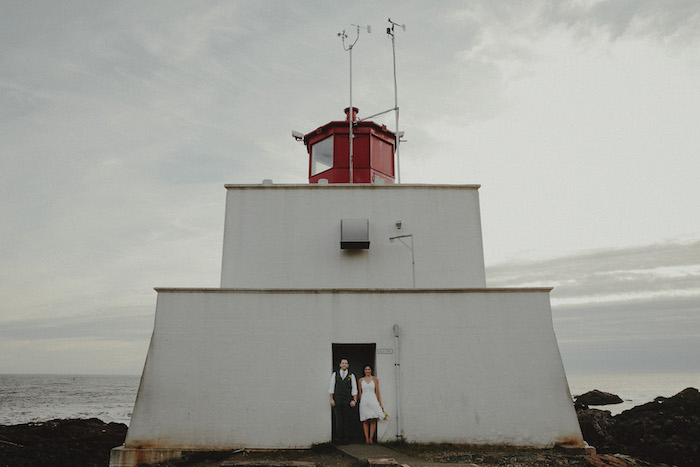 bride and groom portrait in front of lighthouse