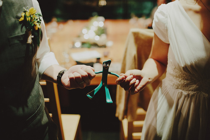 bride and groom holding Gumbi