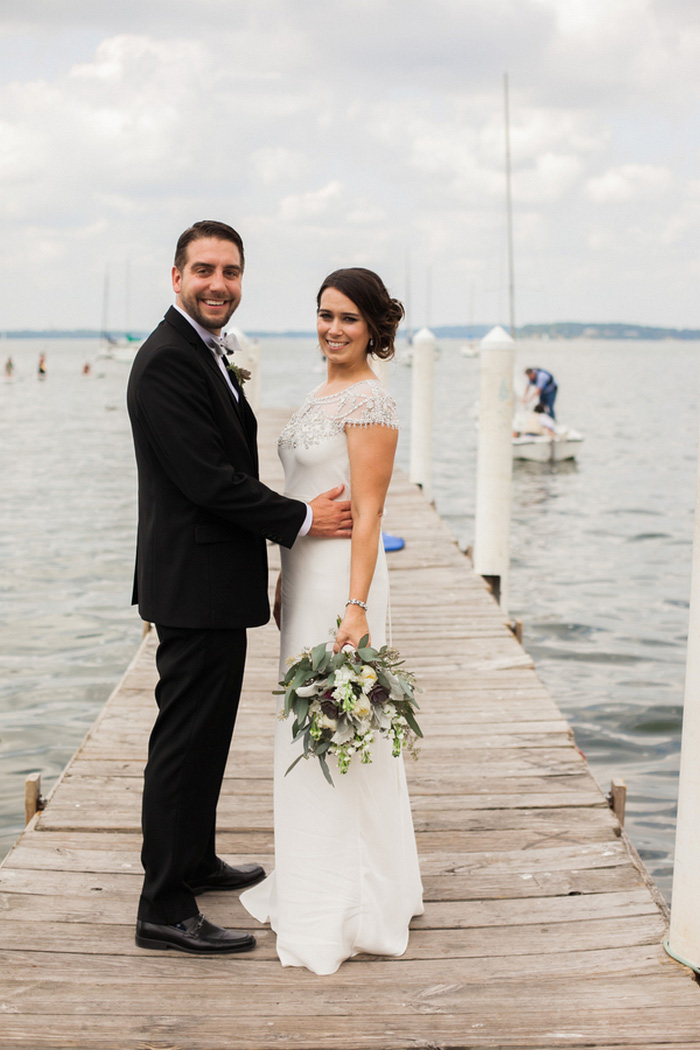 bride and groom portrait by the water