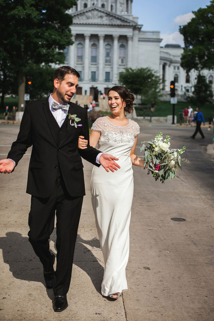 bride and grok walking down the street together