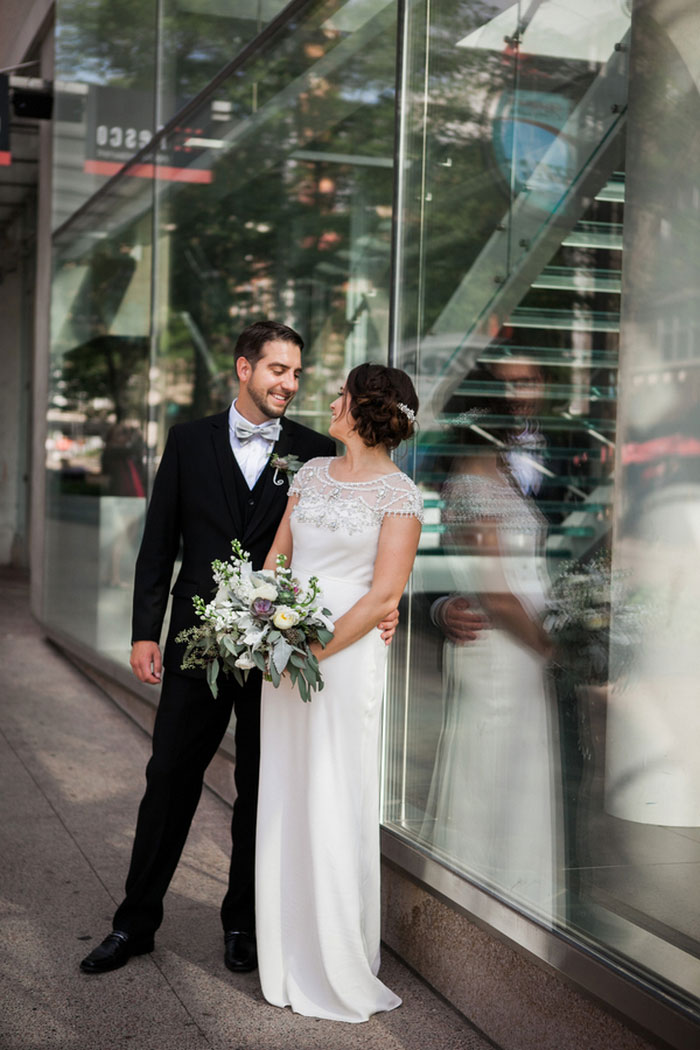 bride and groom portrait outside museum