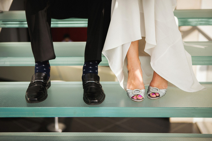 bride and groom's feet on glass stairs
