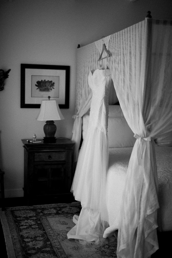 wedding dress hang in up on canopy bed