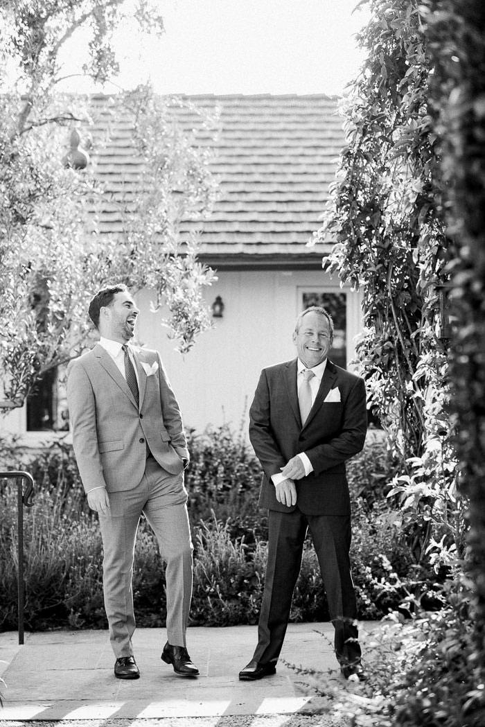 groom laughing with best man