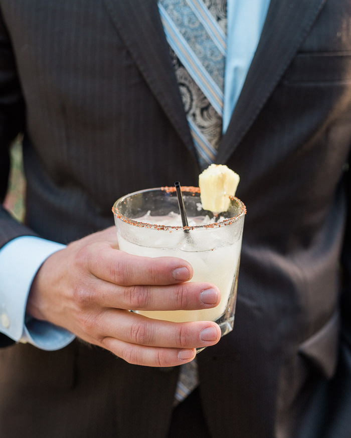 wedding guest holding cocktail