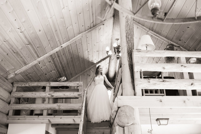 bride at top of cabin stairs