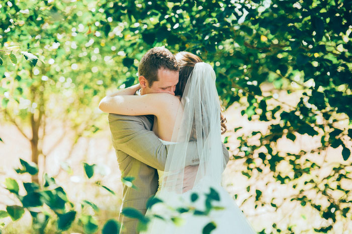 groom hugging bride seeing her for the first time