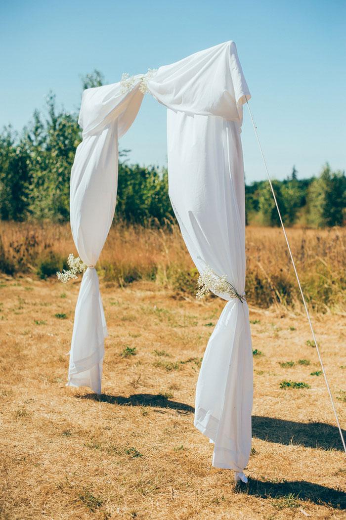white fabric aisle entrance