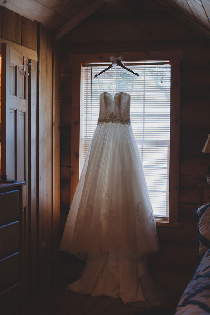 wedding dress hanging on custom hanger