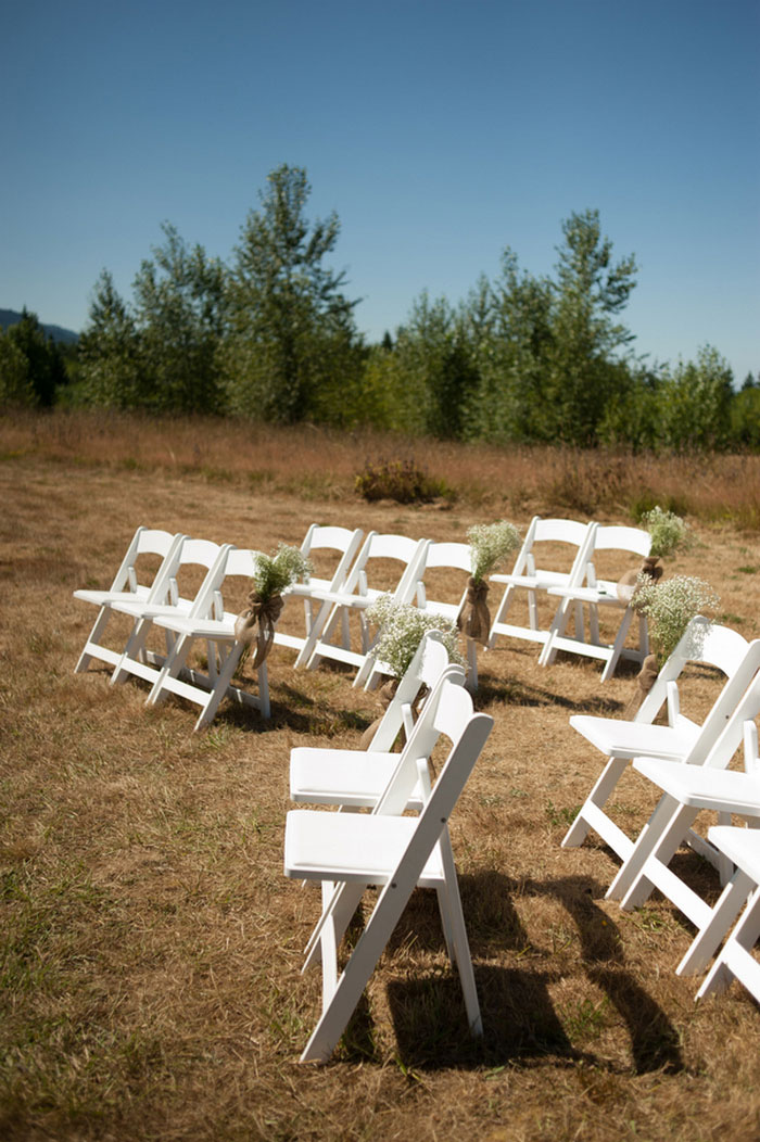white chairs set up outdoors for ceremony