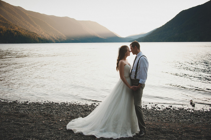 bride and groom portrait by the lake