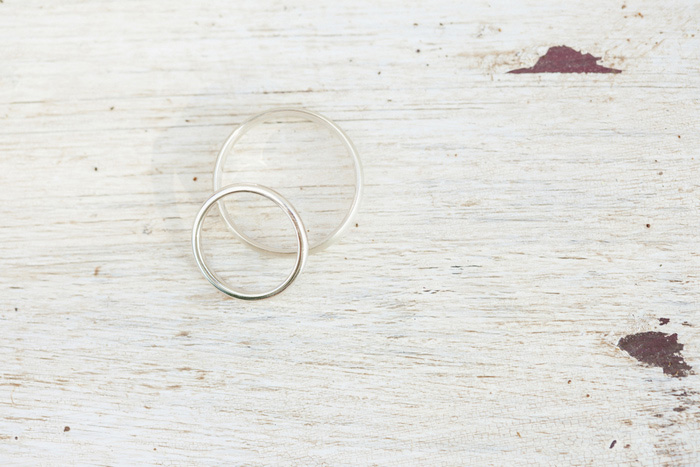 wedding rings on white wood