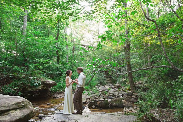 bride and groom portrait in creek