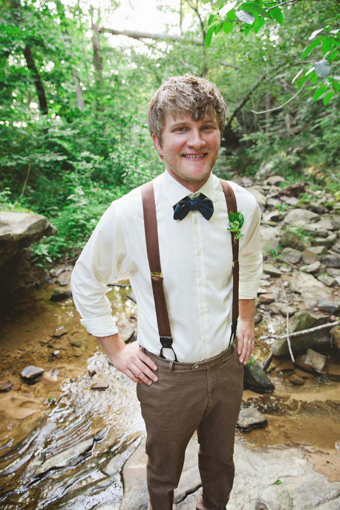 groom portrait in creek