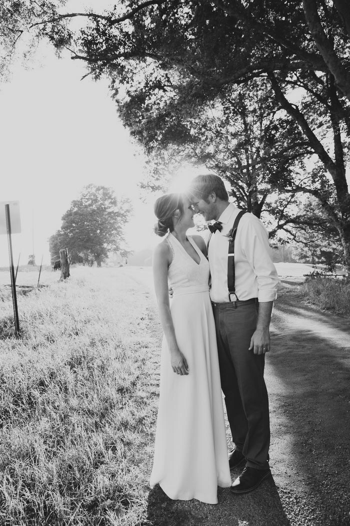 bride and groom portrait on country road