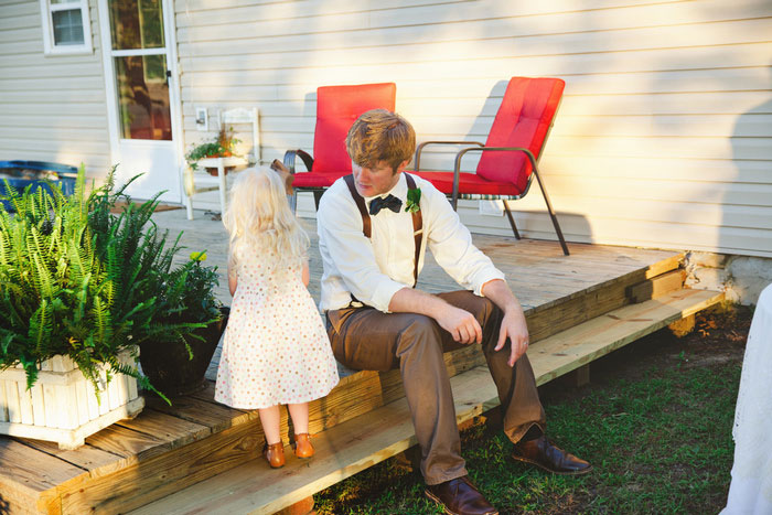 groom with young wedding guest
