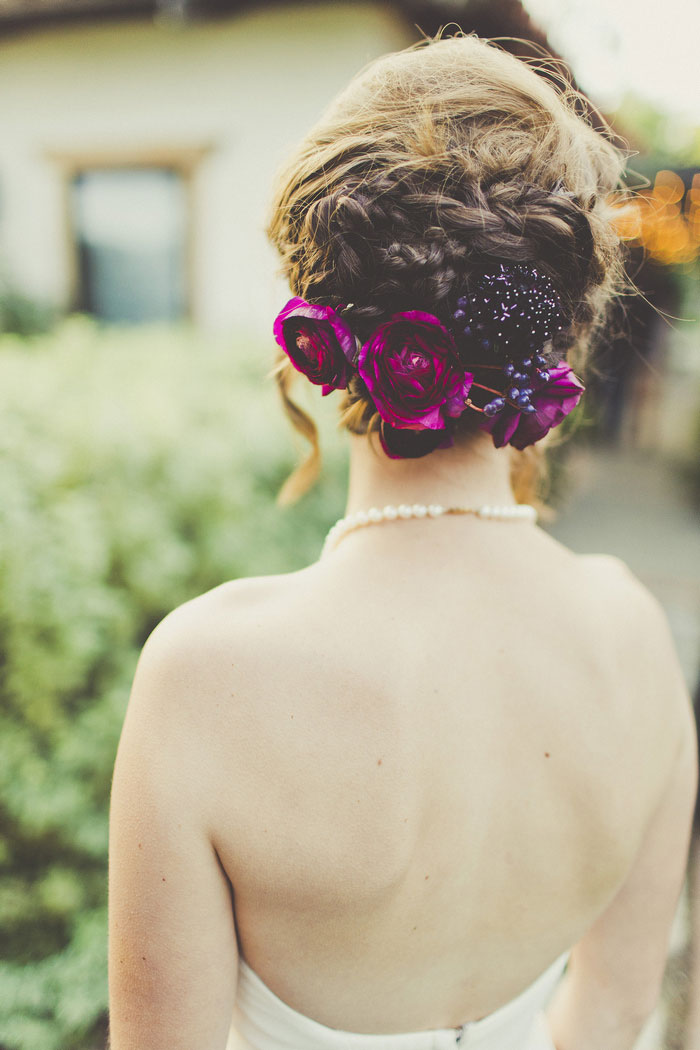 purple flowers in bride's hair