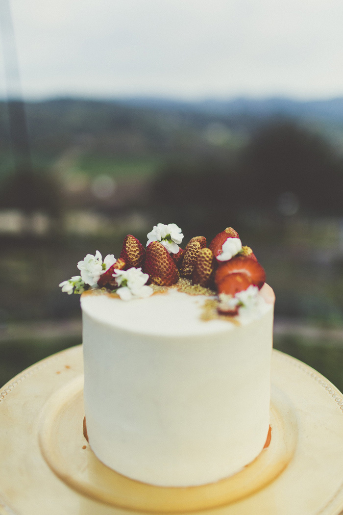 wedding cake with strawberries on top