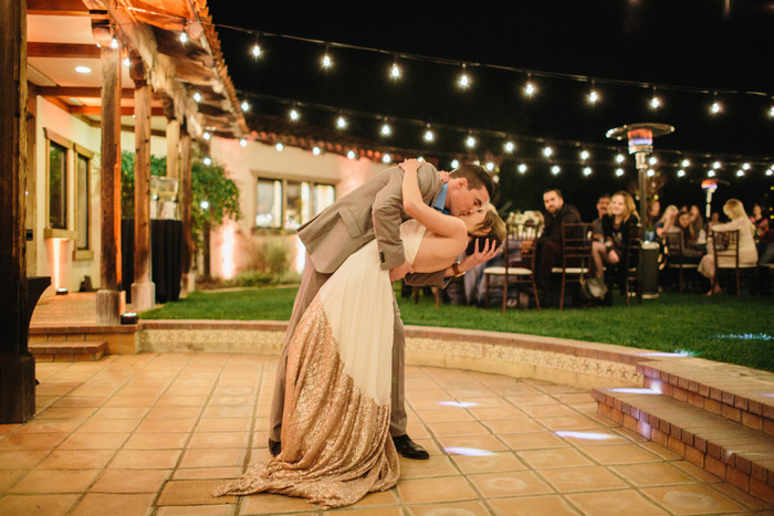 groom dipping and kissing bride on dancefloor