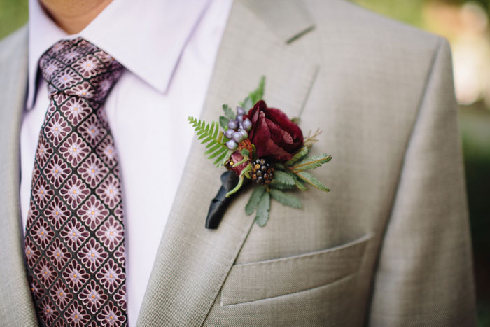 boutonniere pinned to groom's jacket