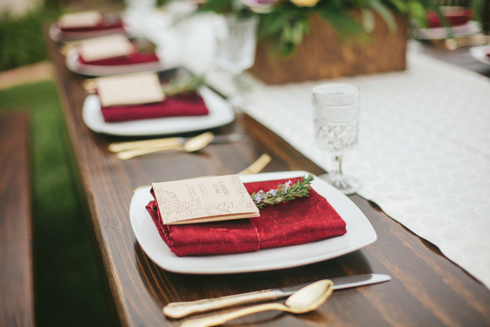 wedding place setting with red napkin