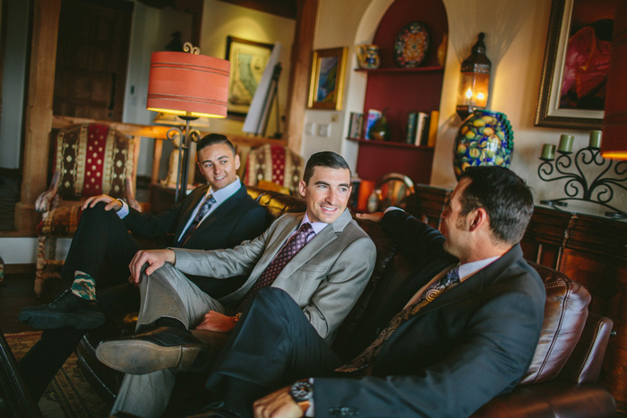 groom relaxing with his groomsmen