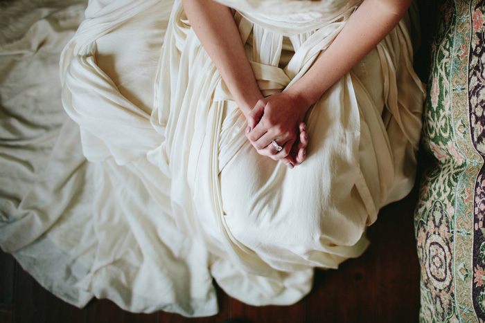 bride's hands folded in her lap