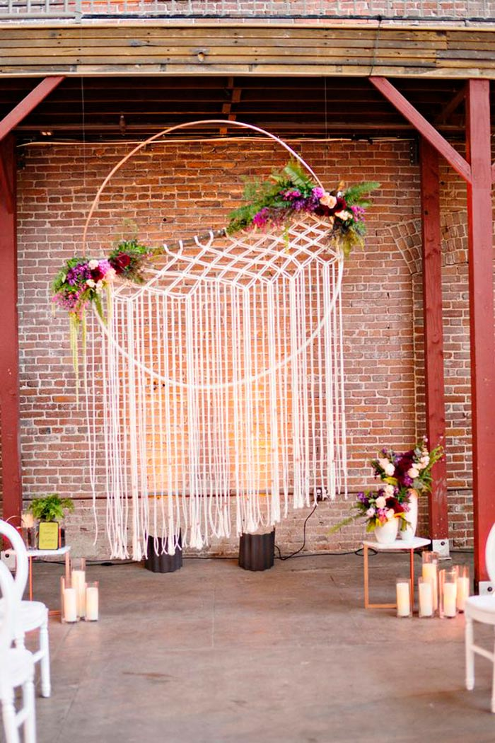 The macrame wedding 10 knotty wedding decor ideas for Altar wall decoration