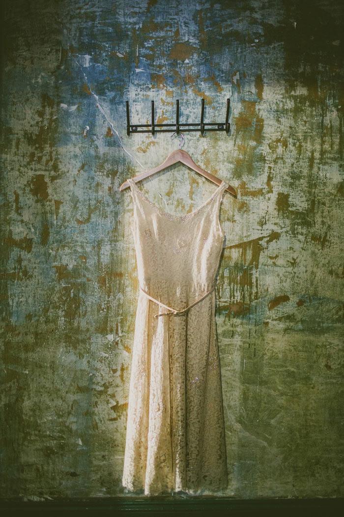 wedding dress hanging on wall