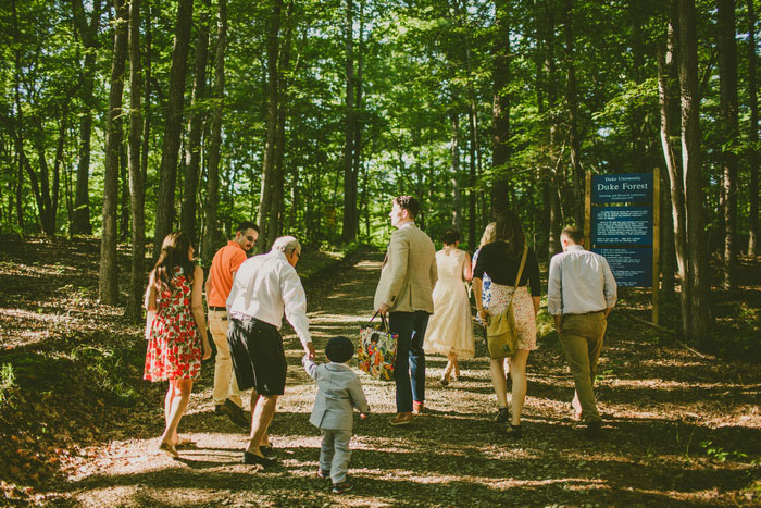 wedding guests walking in the woods