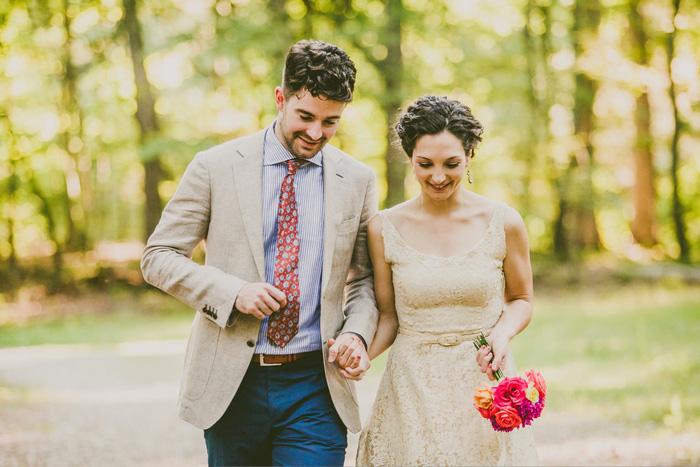 bride and groom walking in the woods