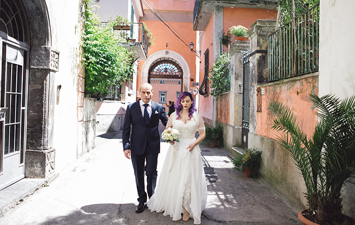 bride walking to the church with her father