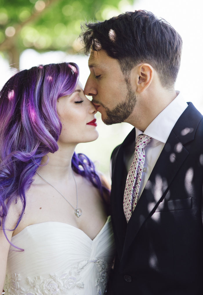 groom kissing bride's nose