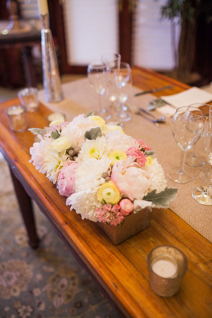 rose and ranunculus wedding centerpiece