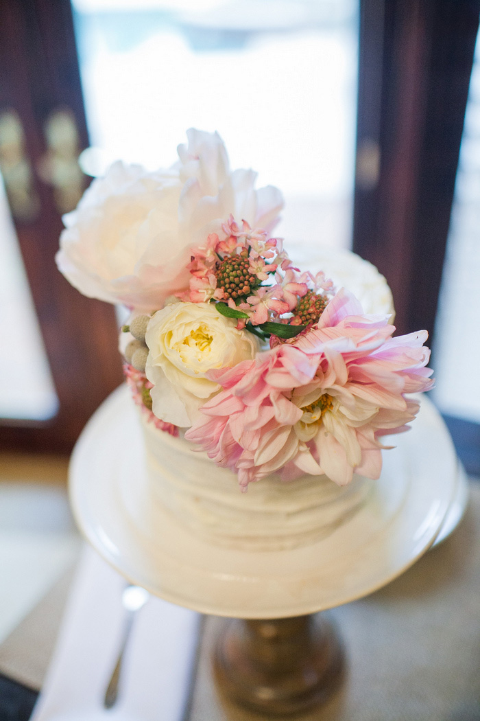 fresh flower covered wedding cake