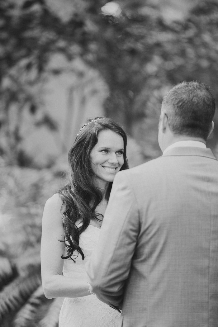 bride smiling at groom during ceremony