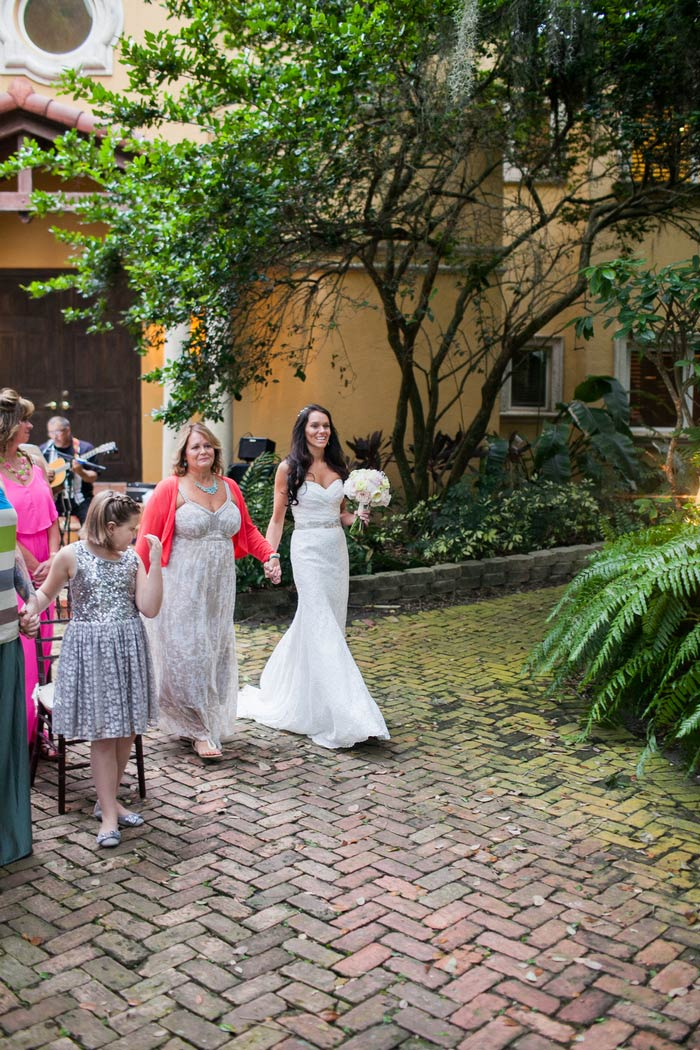 bride walking down the aisle with her mom