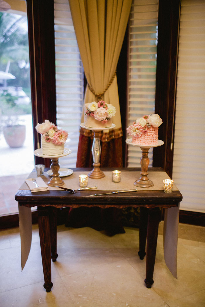 table with 3 small wedding cakes