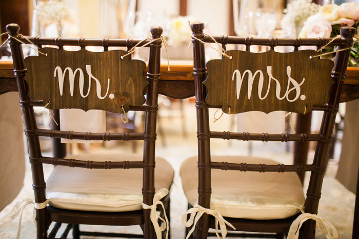 chiavari chairs with wooden Mrs. and Mr. signs on the back
