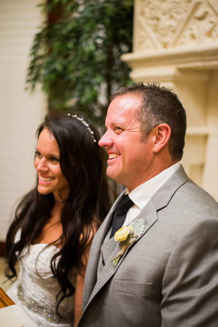 bride and groom smiling during reception