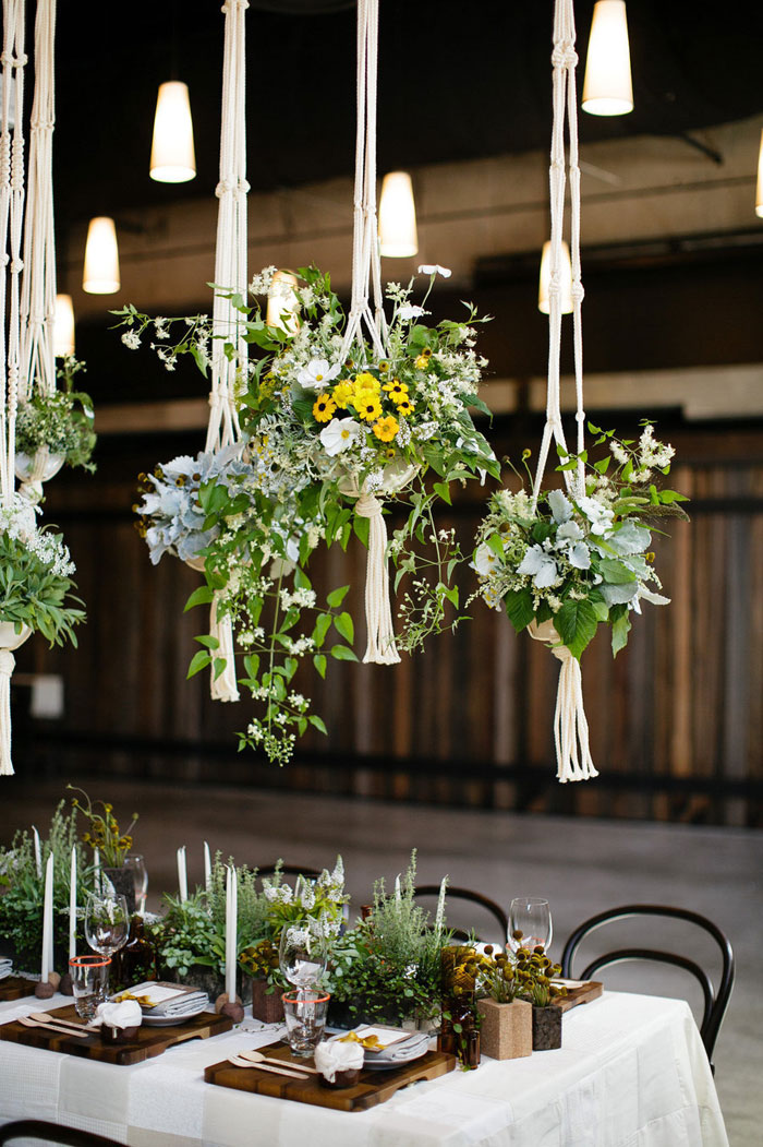The macrame wedding 10 knotty wedding decor ideas for Floral table decorations